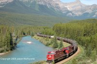 CP AC4400 number 9736 pulls a train of tank cars through Morant's Curve