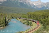 CP AC4400 locomotive 9736 pulls a train of tank cars through Morant's Curve on a sunny July day in 2005.